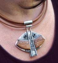 """""""Ninunca"""" collar plata 925,, madera y cuero."""